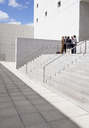 Business people meeting on urban stairs - CAIF00020