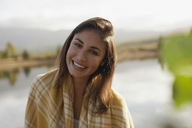 Portrait of smiling woman at lakeside - CAIF00116