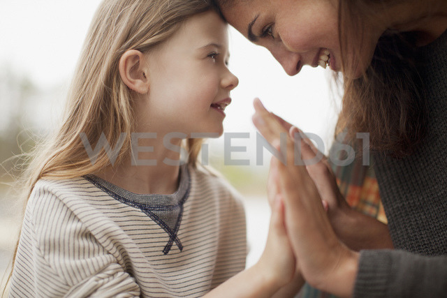 Close up of mother and daughter holding hands - CAIF00152