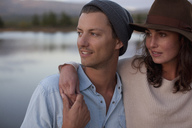 Close up of hugging couple at lake - CAIF00155