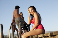 Portrait of smiling woman in bathing suit on dock - CAIF00188