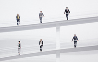 Portrait of business people at railings of elevated walkways - CAIF00245