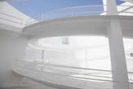 Curving elevated walkway in modern courtyard - CAIF00314