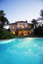 Luxury swimming pool and villa at dusk - CAIF00365