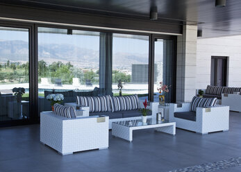 Sofa and chairs on luxury patio - CAIF00374