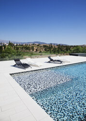 Lounge chairs and swimming pool - CAIF00377