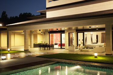 Luxury house and swimming pool illuminated at night - CAIF00392