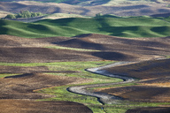 Aerial view of river winding through landscape - CAIF00434