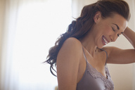 Close up of laughing woman - CAIF00453