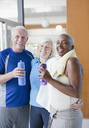 Older people drinking water after workout - CAIF00726