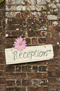 Reception sign on brick wall - CAIF00759