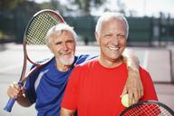 Older men smiling on tennis court - CAIF00861