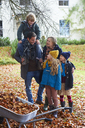 Family standing together outdoors - CAIF00909