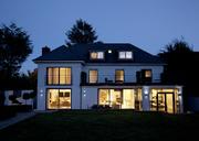 Modern house illuminated at night - CAIF00984