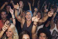 Enthusiastic man cheering in crowd at concert - CAIF01044