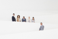 Portrait of confident business people standing on modern stairway - CAIF01134