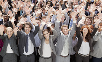 Portrait of cheering business people in crowd - CAIF01176