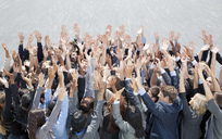 Crowd of business people cheering with arms raised - CAIF01185