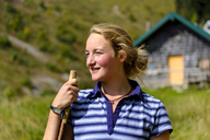 Germany, Bavaria, portrait of smiling young woman in the mountains - LBF01809