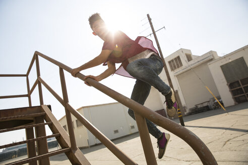 Young man jumping on stairs outdoors - SUF00466