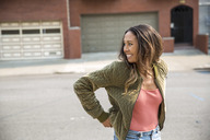 Happy young woman on the street - SUF00502