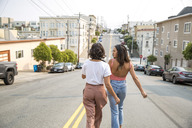 Two young women walking down the street - SUF00508