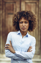 Portrait of serious woman with afro hairstyle outdoors - JSMF00031