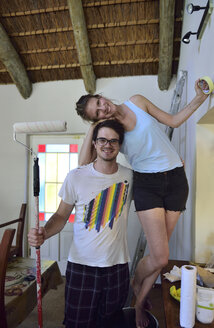 Portrait of happy young couple renovating their home - ECPF00194