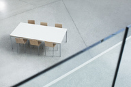 Table and chairs in empty lobby - CAIF01280