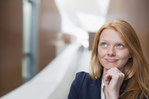 Portrait of pensive businesswoman looking up - CAIF01304