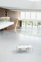 Table and chairs in empty office lobby - CAIF01313