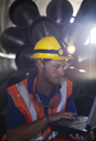 Worker using laptop in tunnel - CAIF01367