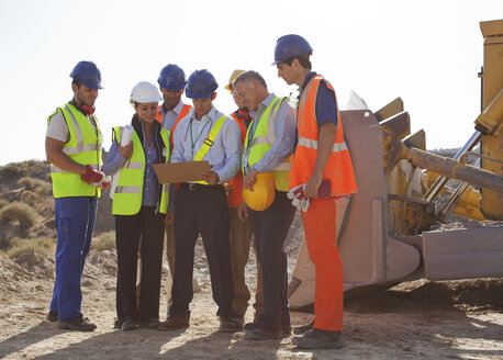 Workers and business people talking on site - CAIF01373
