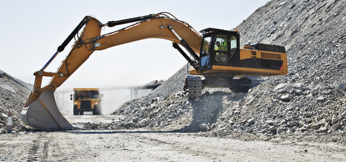 Digger working in quarry - CAIF01379