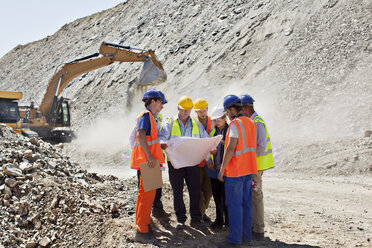 Business people and workers talking in quarry - CAIF01391
