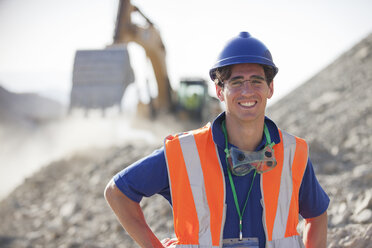 Worker smiling in quarry - CAIF01418