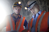 Workers talking in tunnel - CAIF01430