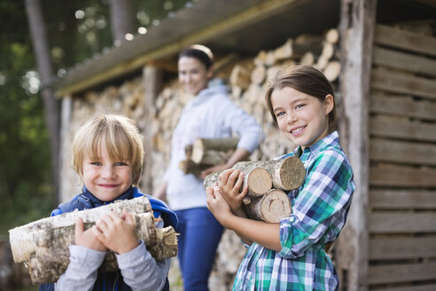 Children carrying firewood outdoors - CAIF01451