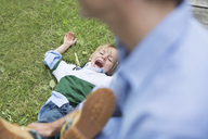Father and son playing outdoors - CAIF01454