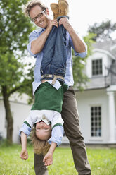 Father and son playing together outdoors - CAIF01469