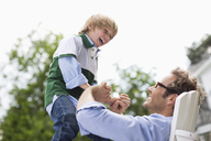 Father and son playing outdoors - CAIF01481