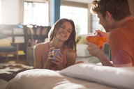 Couple having breakfast in bed together - CAIF01550
