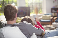 Couple relaxing on sofa together - CAIF01556
