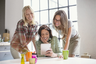 Women using digital tablet together - CAIF01559