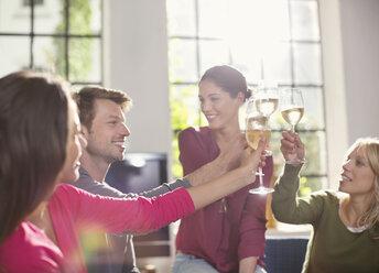 Friends toasting each other with wine - CAIF01565
