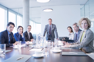 Business people sitting in meeting - CAIF01649