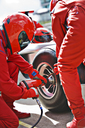 Racing team working at pit stop - CAIF01811
