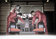 Racing team working in garage - CAIF01814