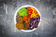 Quinoa-Buddha-Bowl with paprika, avocado, red cabbage, quinoa, quinoa patty, ajvar and black sesame - LVF06746
