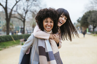 Spain, Barcelona, portrait of two exuberant women in city park - EBSF02174
